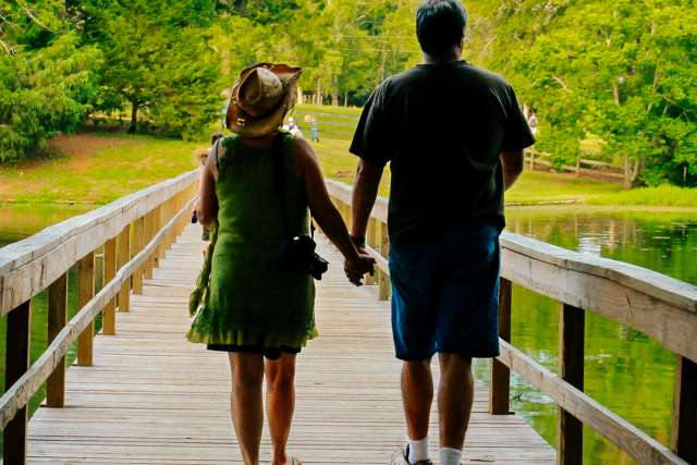 Wife and husband take a walk on the Woods bridge