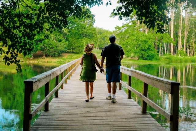 Woods%2Fwoods-couple-holding-hands-bridge