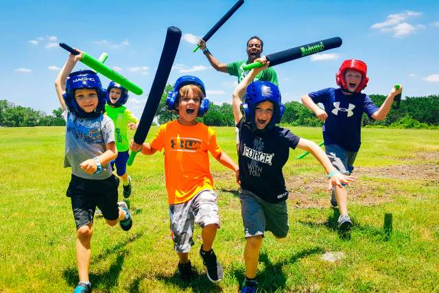 Campers and counselors charge forward with foam swords