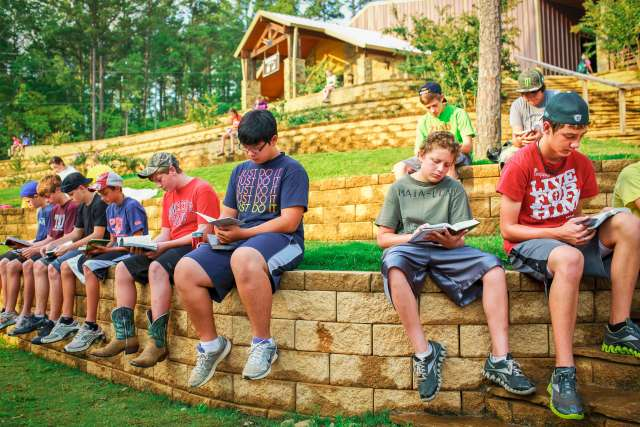 Middle school boys read their Bibles quietly outside the Timbers Dining Hall