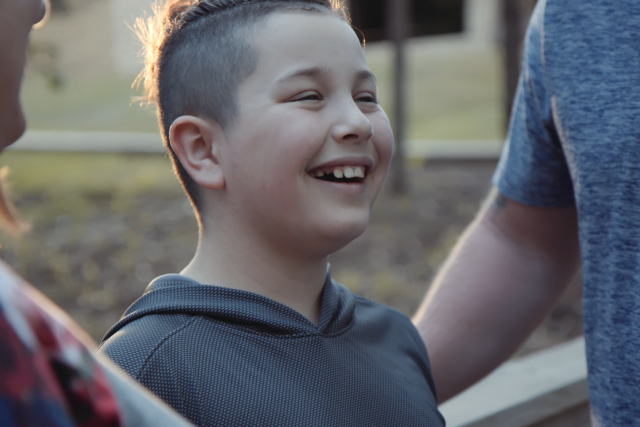 Danger, a scholarship recipient, smiles while at camp