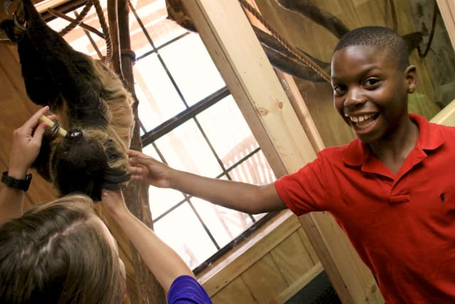 Student gets to pet animals in Critter Class.