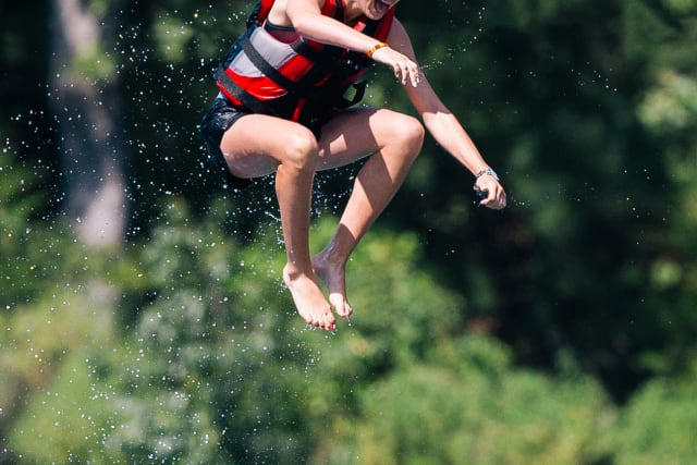 Girl on the blob at summer camp