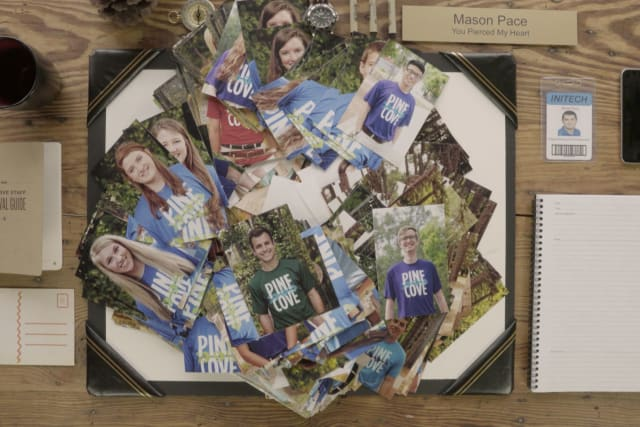 Pile of photos of staff on a table