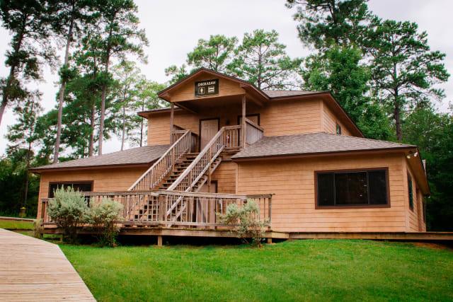 Timbers%2Fovernightcamp-cabin-exterior-wide.jpg