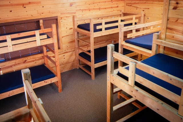 Timbers%2Fovernightcamp-cabin-interior-wide.jpg