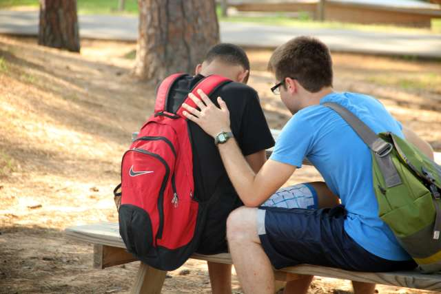 Camper and Counselor Praying