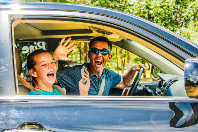 Dad in packed car excited to drop off his girl at camp