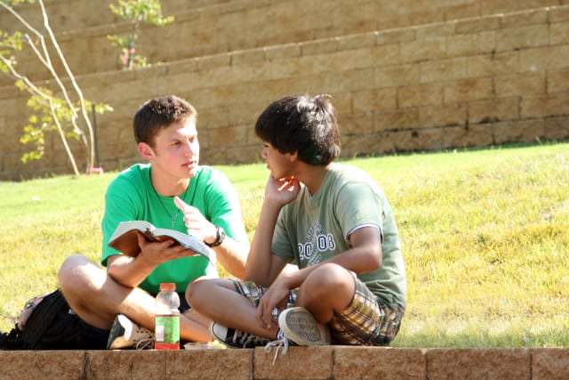 Campers discussing the bible