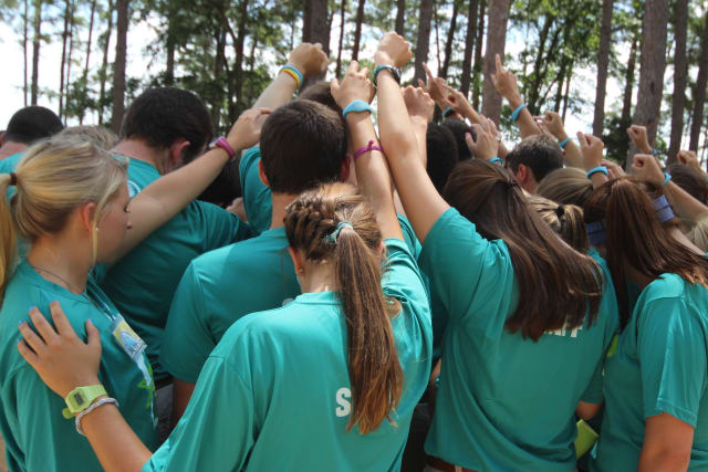 Pine Cove counselors praying