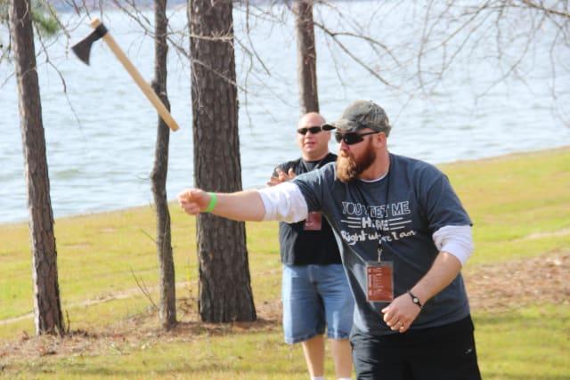 Man throwing hatchet