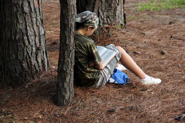 Camper Reading the Bible