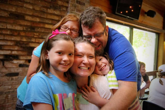 Family Hugging at Camp