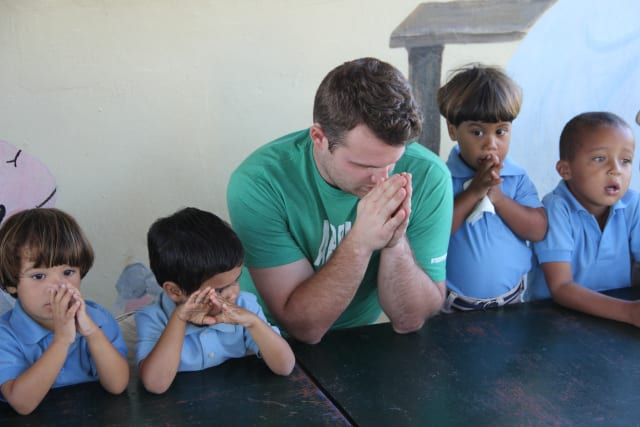 Forge Member Praying with Kids