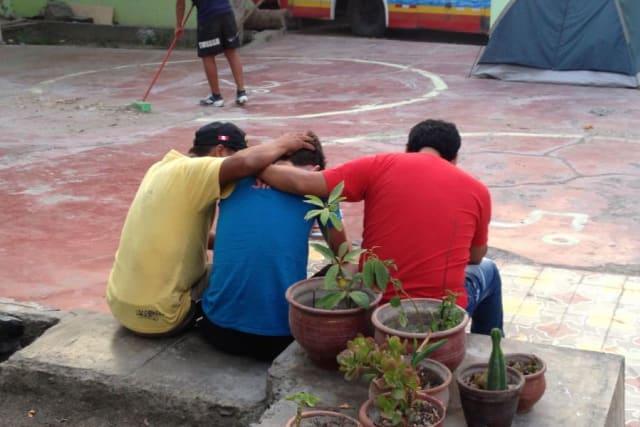 Men Praying at Camp Peru