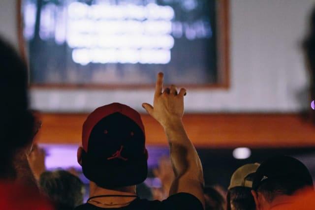 Men worshiping at conference