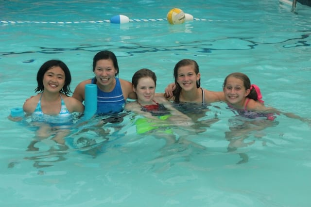 Girl campers in the pool