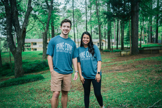 guy and girl with Pine Cove shirts