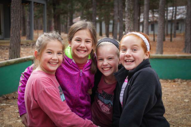 group of girls smiling at camera