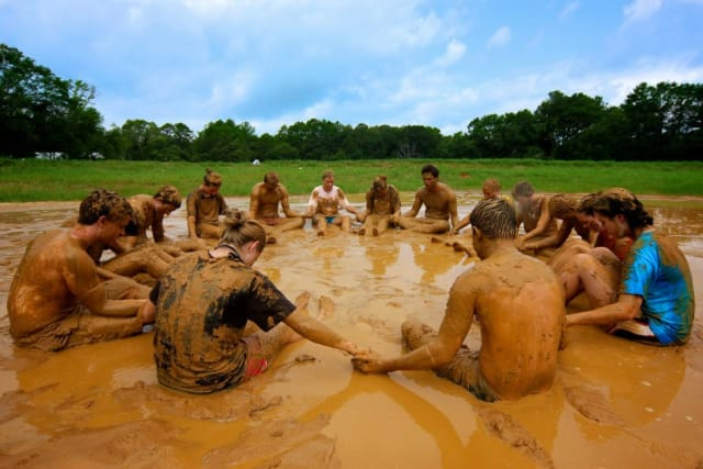 Campers praying in the mud