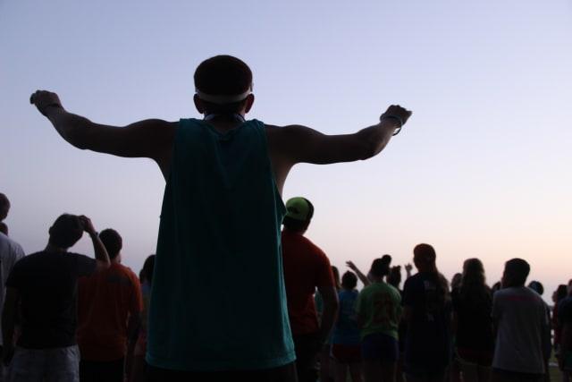 Camper Worshipping Jesus
