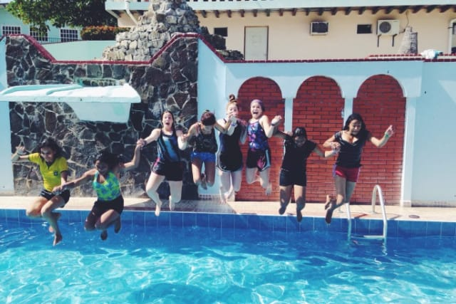 missions campers jumping into pool