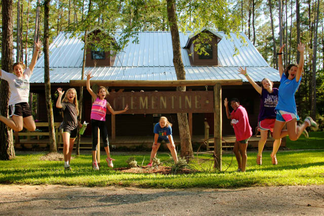 Ranch Cabins with girl campers jumping