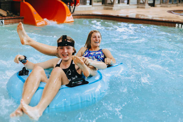 Timbers Amplify two-week campers floating in a lazy river at a water park.