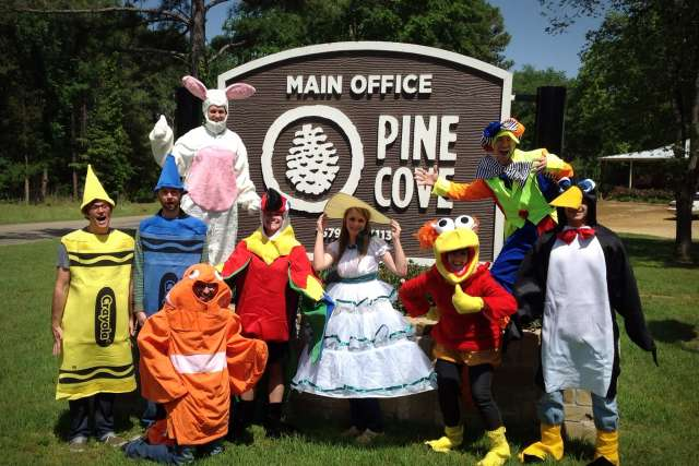 Pine Cove full-time staff members dress up in costumes outside of the office.