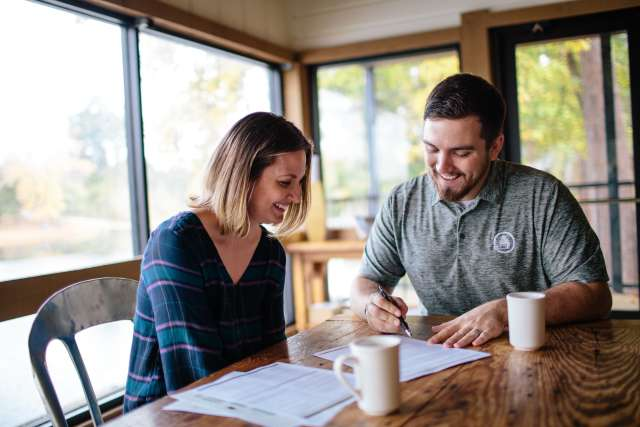 Retreat host and guest discuss details in a coffee shop
