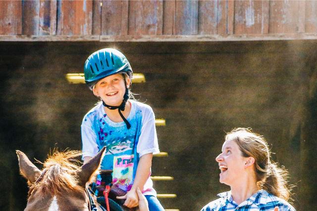 staff leading a horseback ride