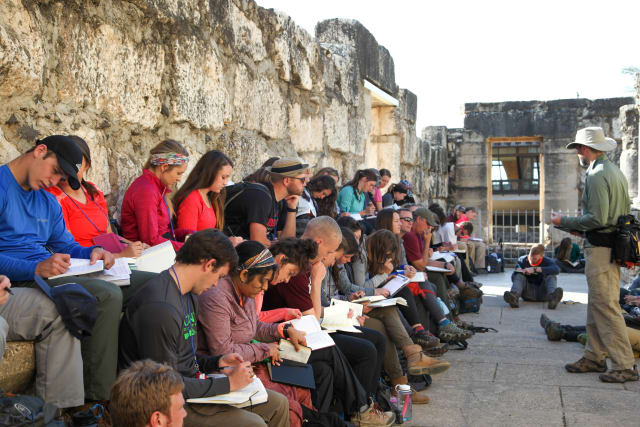 Forge students take notes as the learn from a speaker in Israel.