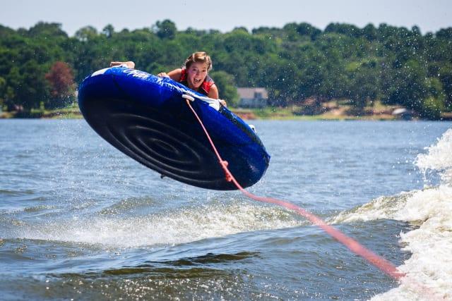 girl tubing on lake