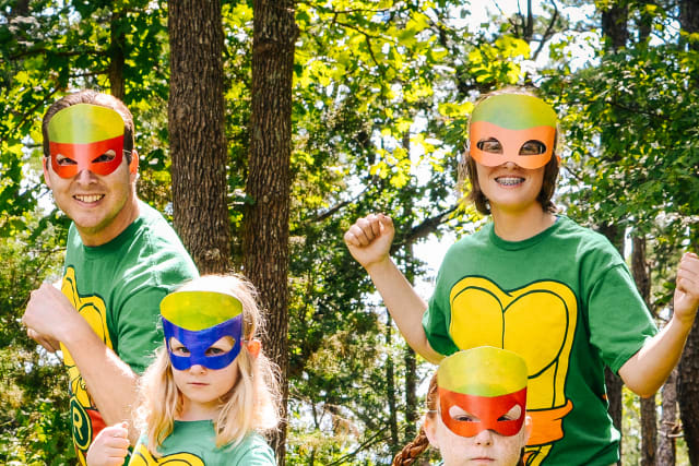 A family dresed like ninja turtles for a theme night
