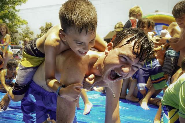 Camper and counselor playing on a water activity