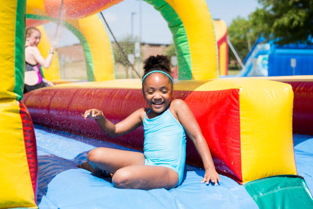 boy goes through inflatable obstacle course