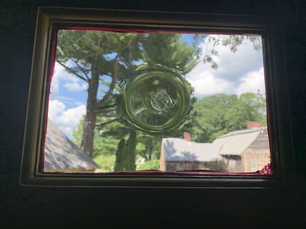 Glass blowers small window at Sturbridge Village