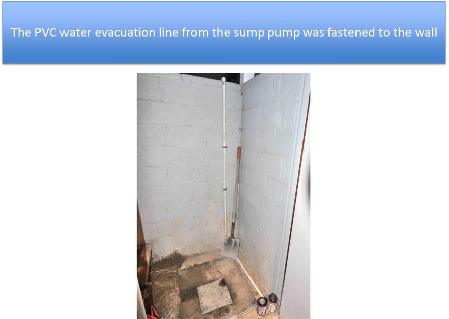 Discharge Pipe Fastened To Wall