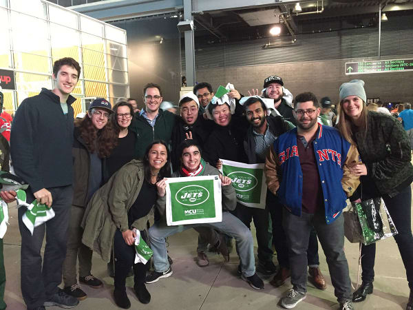 Photo of the Agency Within team during one of their outings at a Jets game.