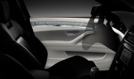 Polycarbonate-based material for automotive interiors