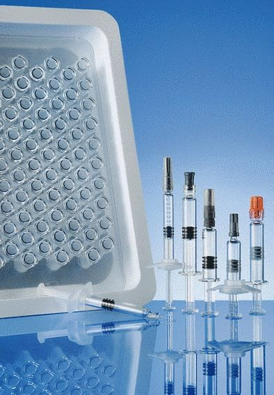 Glass and plastic syringe systems at the PDA