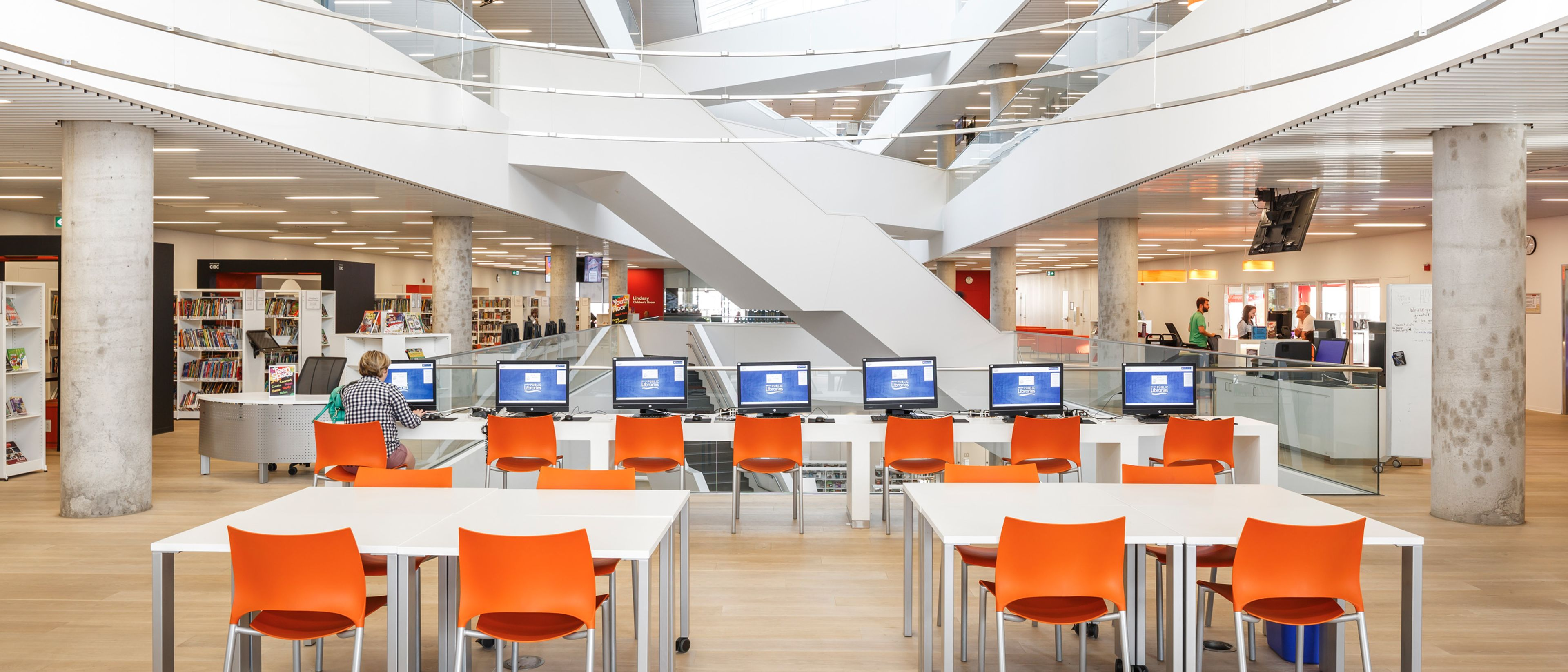 Halifax Central Library main computer lab shows a wide open modern looking space built by ellisdon