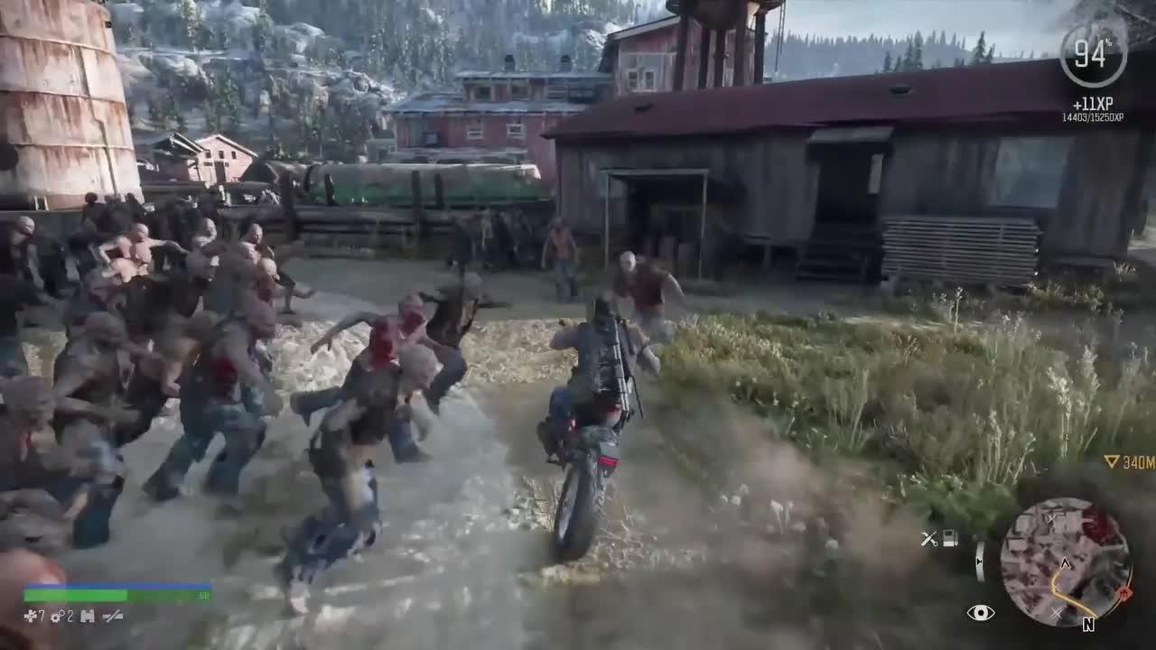 Days Gone главный герой едет на мотоцикле от зомби