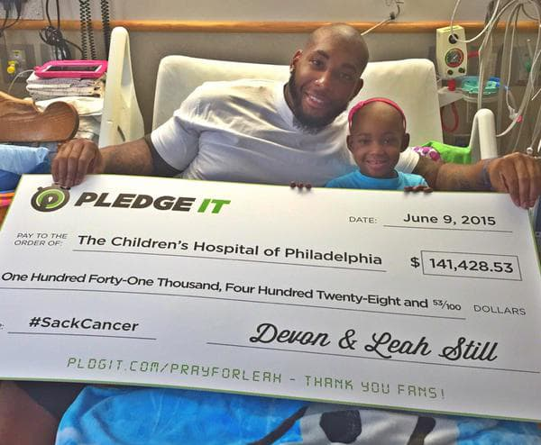 Devon Still presents check from earned pledges