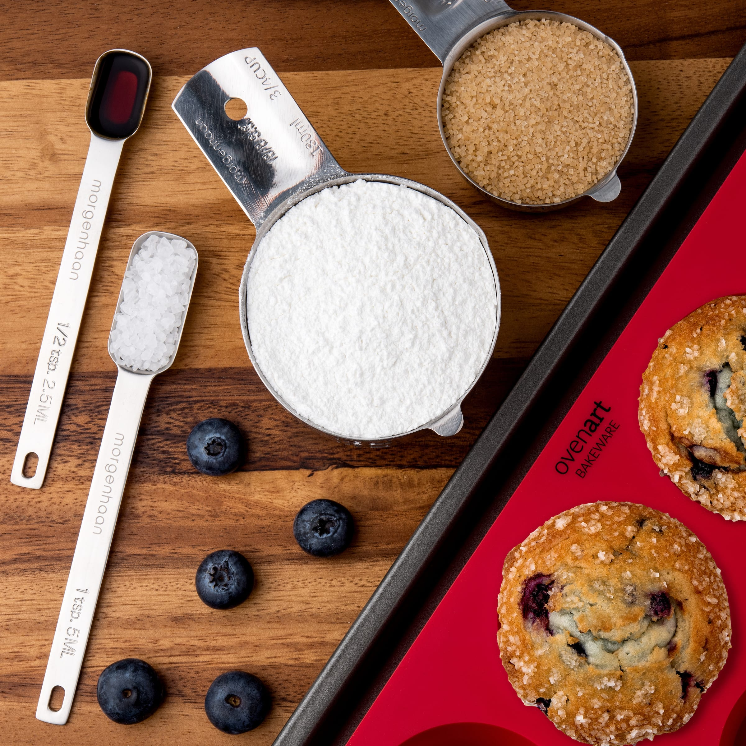 Measuring cups, measuring spoons and muffin tray