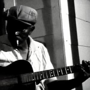 A candid shot of the delta bluesman, Belton Sutherland, from when Alan Lomax visited him in the 1970s