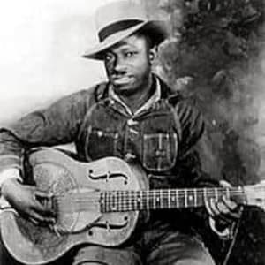 The only known photo of Robert Petway. He's posing with his National resonator, denim clothing, and audacious headwear.