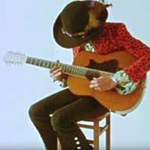 Jimi Hendrix Playing a 12 String Guitar