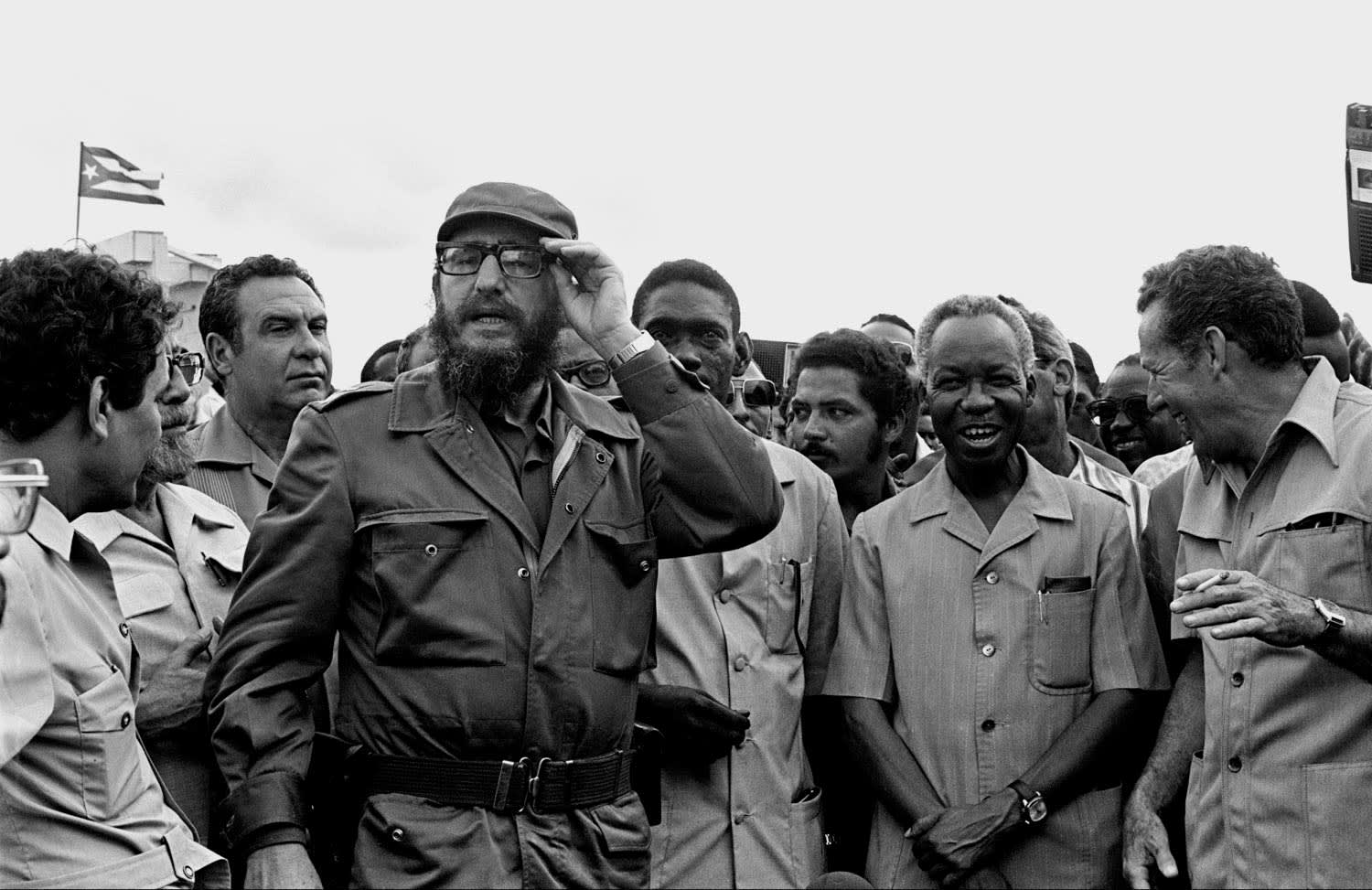 Cuban President Fidel Castro (left) with his younger brother Raul Castro (right), accompanied by President Julius Nyerere of Tanzania (centre) during a visit to a Cuban-funded agriculture school in Tanzania, 1977. Courtesy Mohamed Amin Foundation/AKKA Project