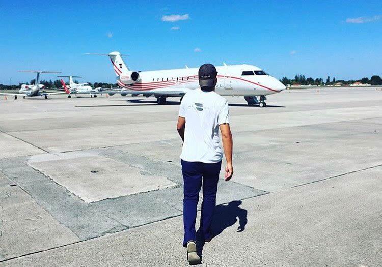 Blade walking towards jet plane